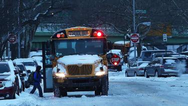 A school bus picks up children in Brooklyn