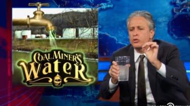 Jon Stewart drinks water