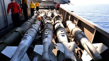 U.S. service members load missiles for anti-ISIS airstrikes