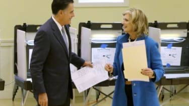 Mitt Romney and his wife Ann Romney vote at a polling station