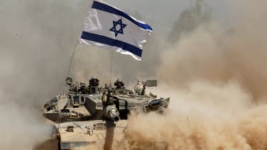 An Israeli tank returns from Gaza