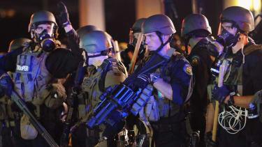 Police in Ferguson came under 'heavy gunfire' last night, commander says