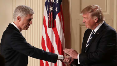 President Trump shakes the hand of Neil Gorsuch