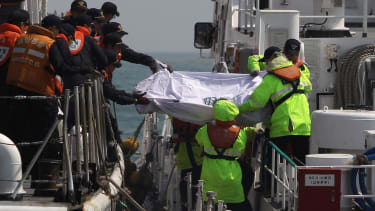 Reports: South Korean ferry was carrying three times more cargo than normal