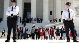 Immigration supporters on the steps of the Supreme Court.