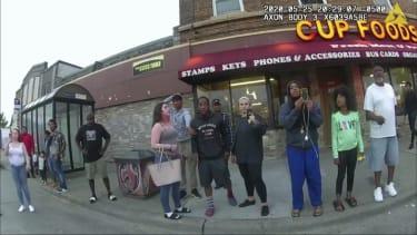 Bystanders watch as George Floyd is arrested in May 2020.