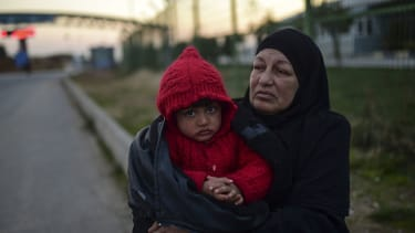 A Syrian refugee with her grandson