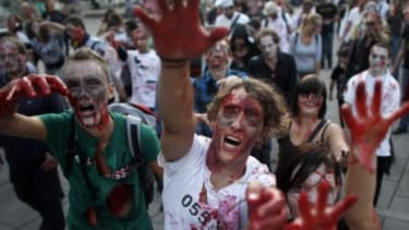 A zombie flashmob: Zombies have inspired movies, Halloween costumes, and even Occupy Wall Street garb giving a boost to the near-dead economy.