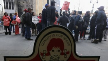 Fast food workers protest for better wages outside a Wendy's restaurant in New York, April 4.