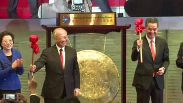 Watch Chinese officials ring the opening gongs of the Hong Kong-Shanghai linked stock exchanges