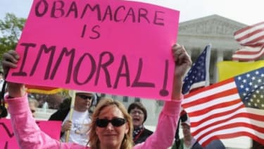 Opponents of President Obama's health care legislation protest in March: Only 24 percent of Americans polled said the Supreme Court should uphold the entire law.