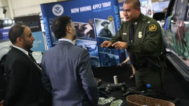 ICE agents pitch their job at a border security fair