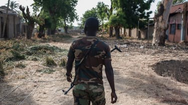 A Nigerian soldier patrols an area attacked by Boko Haram