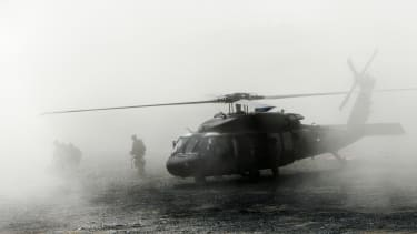 Troops disembark a helicopter in Afghanistan, 2009.