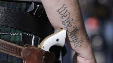 A man wearing a pistol.