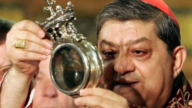 Cardinal Crescenzio Sepe holds the relic containing San Gennaro liquified blood