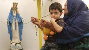 An Iraqi Christian refugee, and child, in 2011.
