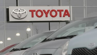 The Toyota logo at a car dealership