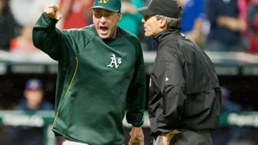 Oakland A's manager Bob Melvin yells at umpire Angel Hernandez after a game-tying home run was wrongly called a double.