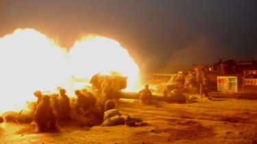 Korean People's Army (KPA) artillery troops conduct a live firing exercise