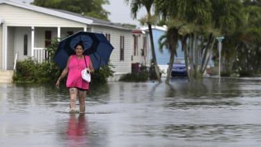 A woman walks through her flooded neighborhood in Davie, Florida, ahead of Hurricane Irma.