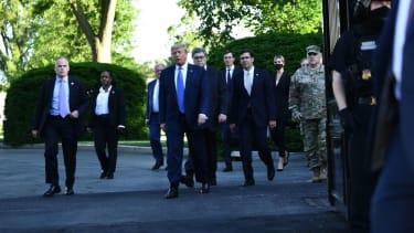 Trump and company head to St. John's photo op