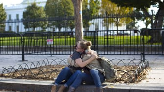 Two women embrace in front of the White House on Nov. 9, 2016.