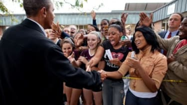 Obama gets a warm reception at a Wisconsin high school last September.