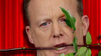 Former White House Press Secretary Sean Spicer with a rose in his mouth.
