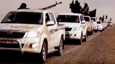 Islamic State fighters in Toyota trucks.