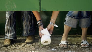 People pass a roll of toilet paper.