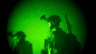U.S. Special Operations forces are seen through a vision night scope in Afghanistan, Dec. 11, 2011.