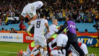 Team USA celebrates a win against Algeria in today's World Cup match.