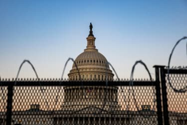 The Capitol as seen behind barbed wire.