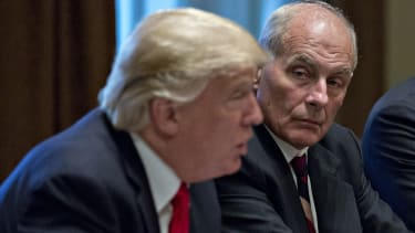 John Kelly and President Trump in a briefing