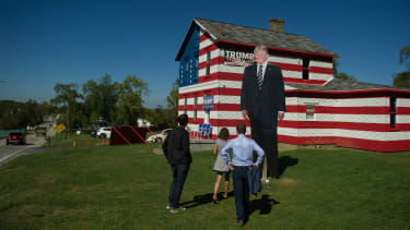 Trump supporters gather at a Trump-decorated house in Youngstown, Pennsylvania.