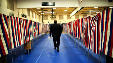man walks past red white and blue voting booths but doesnt even have the constitutional right to vote!