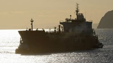 A oil tanker pulls into a Spanish port: Iran has cut off oil shipments to France and Britain, and has also threatened to stop sales to Spain and other EU countries.