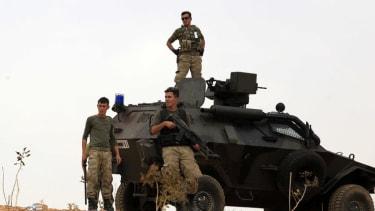 As Kurdish fighters hang on in Kobani, Turkey bombs Kurdish targets