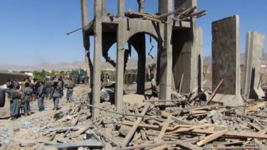 Afghan policeman at site of suicide bombing.