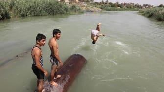 Iraqis try to cool off during the summer.