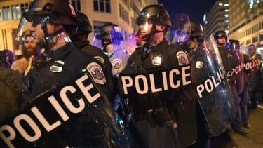 Police keep back protesters outside the National Press Club in Washington, D.C.