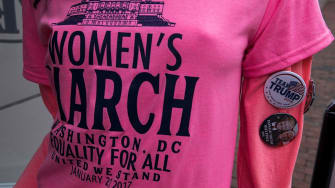 A t-shirt on a mannequin wearing a Women's March and Donald Trump buttons is pictured before President-elect Trump's inauguration January 20, 2017 in Washington, DC.