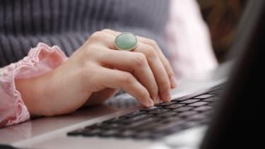 Woman checking laptop