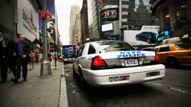 An NYPD car parked in Times Square.