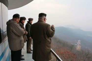 North Korean leader Kim Jong Un watches a rocket engine test
