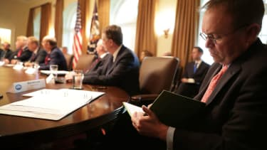 Mick Mulvaney takes notes of Trump meeting