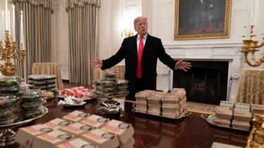 Trump serving fast food.