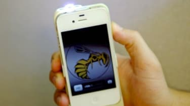 A prototype of the Yellow Jacket stun gun in action: The iphone doubles as a 650,000-volt weapon at your ready should a surprise attack happen.