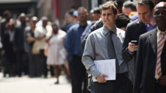 Applicants wait to enter a June job fair in New York City: The U.S. economy added just 80,000 jobs in June, falling short of six-figure expectations.
